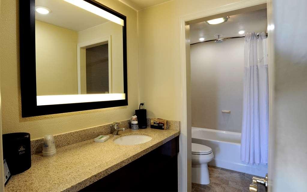 Best Western Plus Clocktower Inn - Pool area king or double queen rooms bathroom. Bathrooms have heated tile flooring.