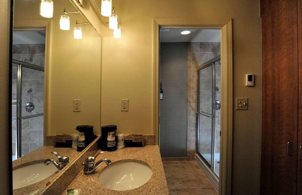 Best Western Plus Clocktower Inn - Pool area room bathroom includes heated tile flooring, and an additional rain shower.