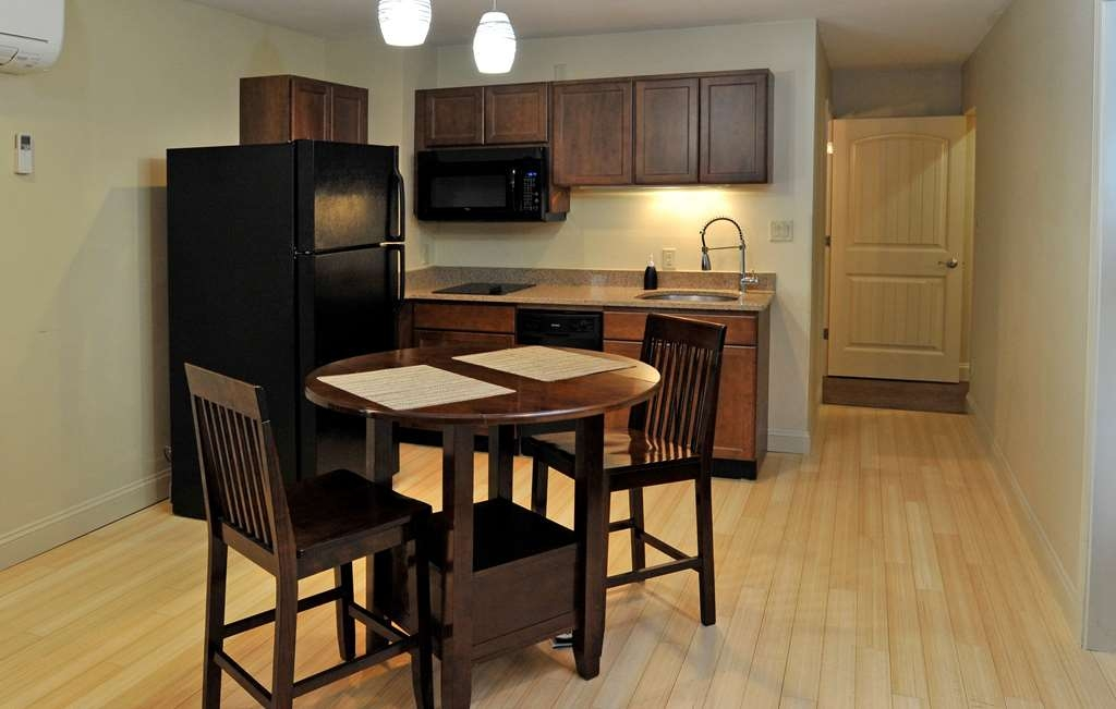 Best Western Plus Clocktower Inn - Our king suite has a full kitchen, living room with pullout couch, 2 full bathrooms and a private separate bedroom.
