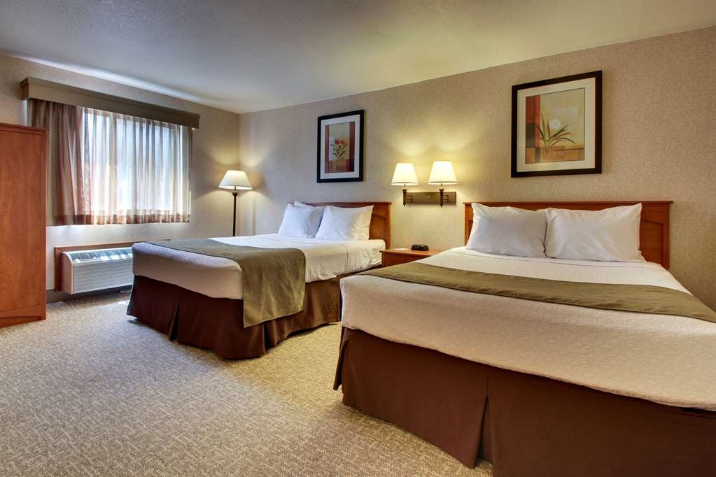 Best Western West Hills Inn - Our standard room with two queen beds offers a great value and exceptional comfort. Want an exterior door to the courtyard or parking lot? Just ask!