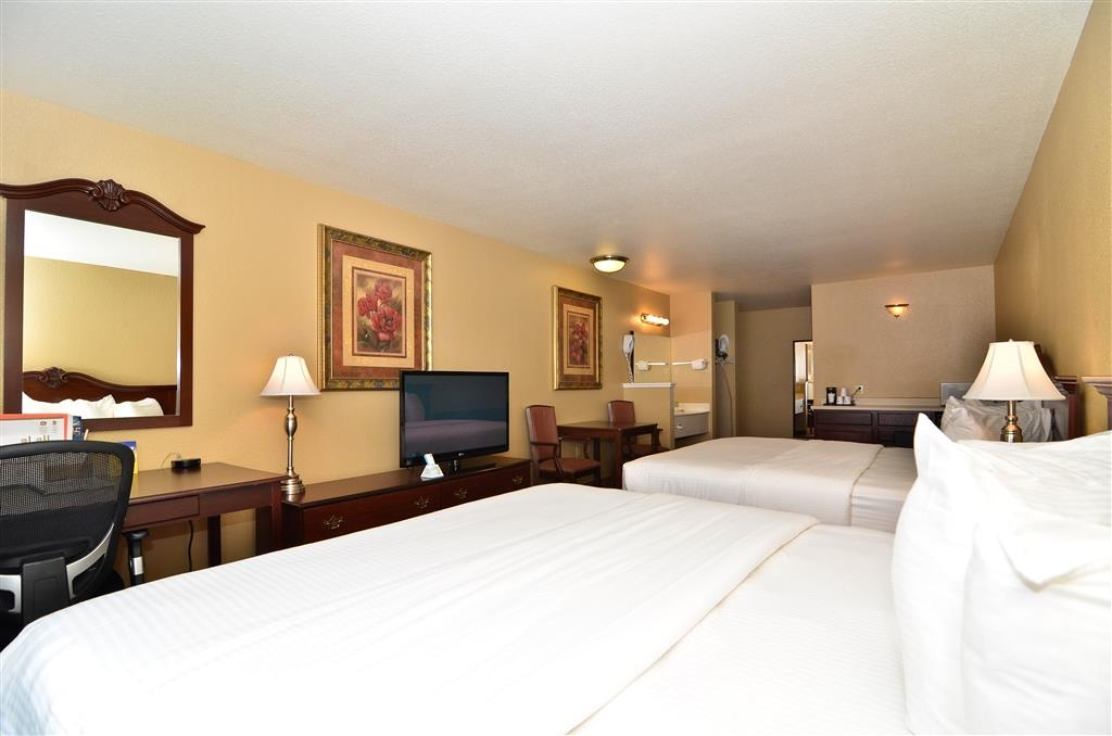 Best Western Fallon Inn & Suites - Guest room with two king beds, leather sofa, mini-refrigerator, safe box, microwave and 42-inch flat screen television.