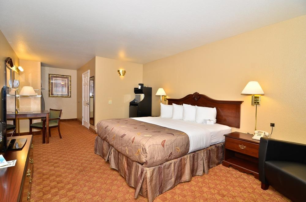 Best Western Fallon Inn & Suites - California King bed non-smoking room with a 42-inch plasma TV, safe box, sofa chair, mini-refrigerator and microwave.
