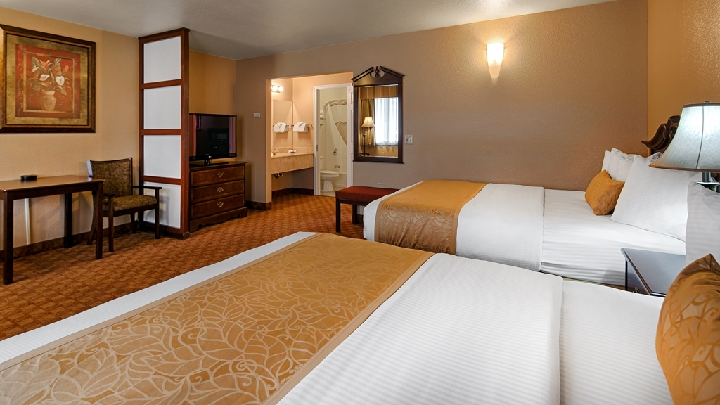 Best Western Fallon Inn & Suites - Two-room suite with two queen beds in one room and a separate living area. Suite is equipped with two HD, cable televisions.