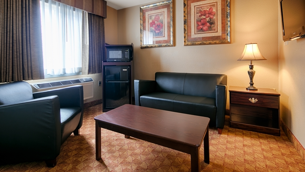 Best Western Fallon Inn & Suites - Two-room suite with two queen beds in one room and a separate living area with microwave and mini fridge.