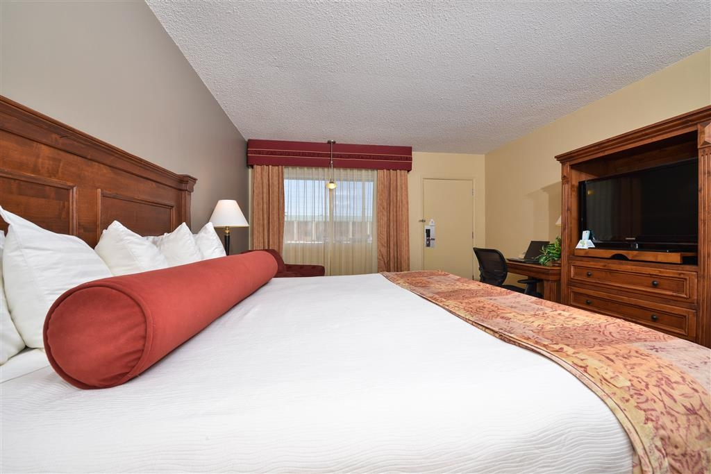 Best Western Plus King's Inn & Suites - Our king guest rooms have modern walk-in showers with rain showerheads, benches, and glass doors. We feature 37-inch LCD televisions.