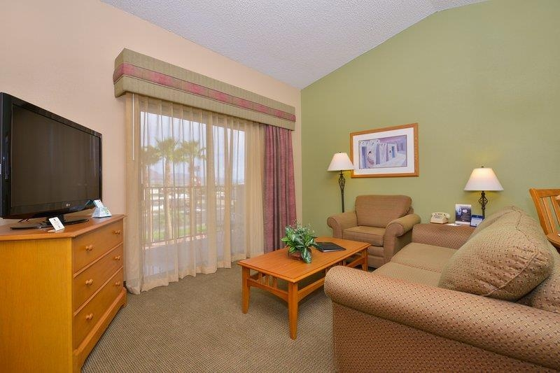 Best Western Plus King's Inn & Suites - Our executive suites include spa tub/showers, rain showerheads, king beds, multiple televisions, and a balcony with mountain views.