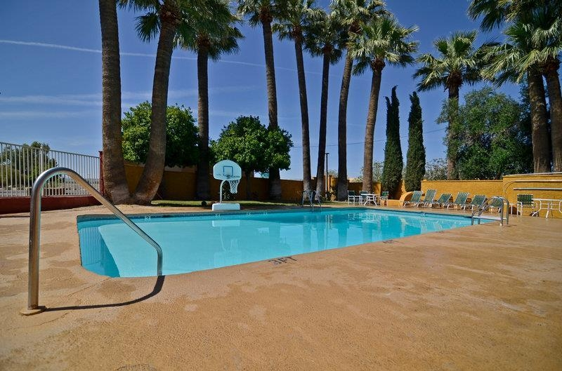 Best Western Rancho Grande - The pool area at the Best Western Rancho Grande features comfortable lounge chairs as well as shaded seating areas.