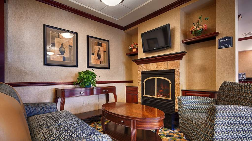 Best Western Monroe Inn & Suites - Stay warm by the fireplace or settle into one of the comfortable chairs.