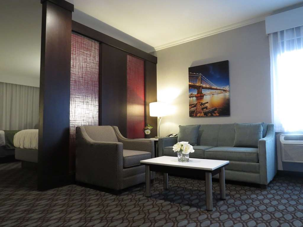 Best Western Premier NYC Gateway Hotel - Use the sofa-bed in our Queen Suite room for extra sleeping space, without the cost of an additional room.
