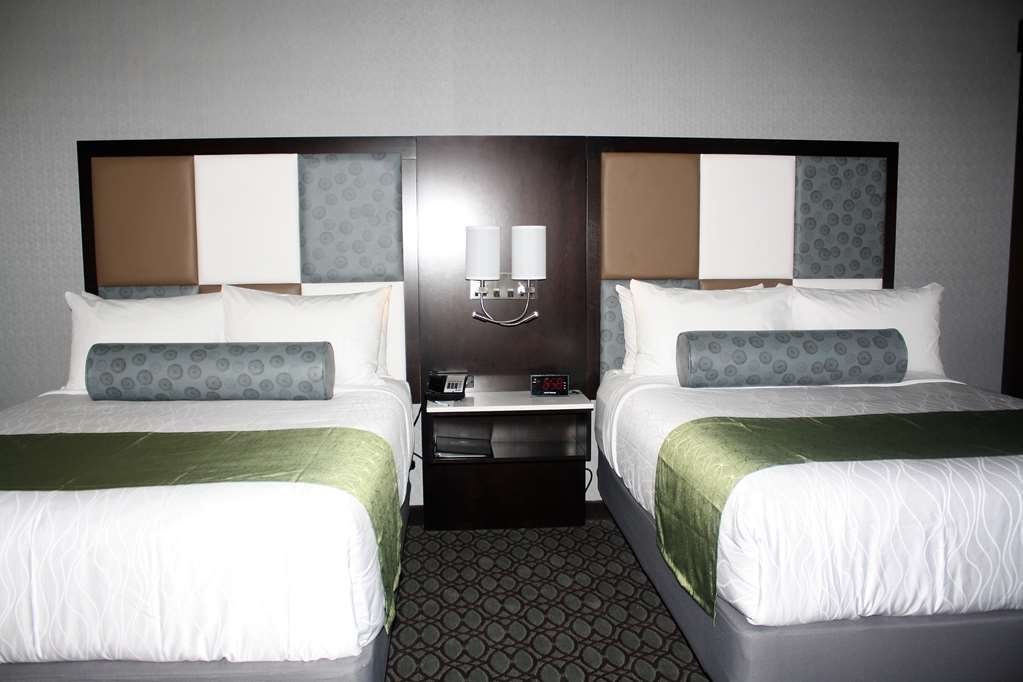 Best Western Premier NYC Gateway Hotel - Sink into our comfortable beds each night and wake up feeling completely relaxed.