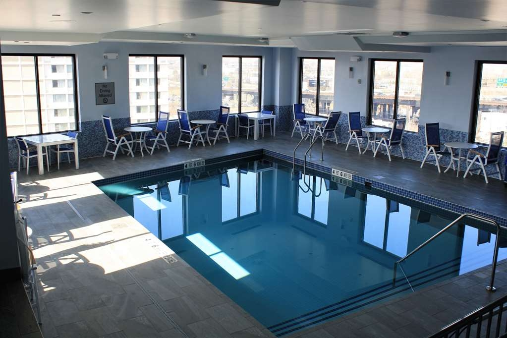 Best Western Premier NYC Gateway Hotel - Whether you want to relax poolside or take a dip, our indoor pool area is the perfect place to unwind.