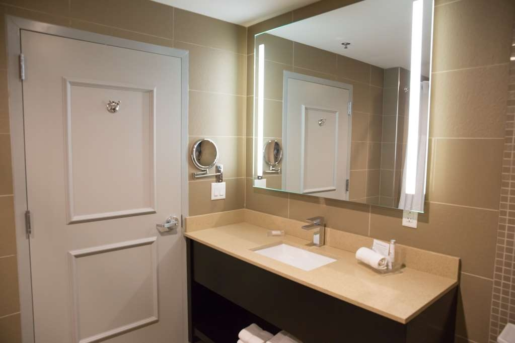 Best Western Premier NYC Gateway Hotel - All our King Suite Bathrooms have a large vanity with plenty room to unpack the necessities.