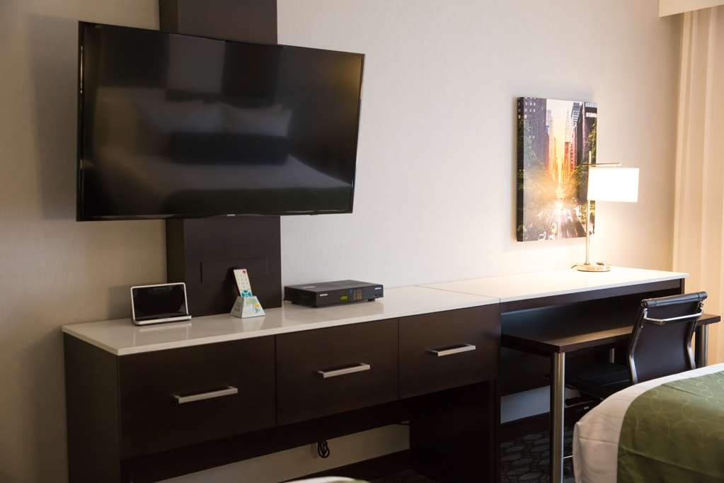 "Best Western Premier NYC Gateway Hotel - Pull back the covers, hop in and catch your favorite TV show on a 50"" Screen featured in all guest rooms."