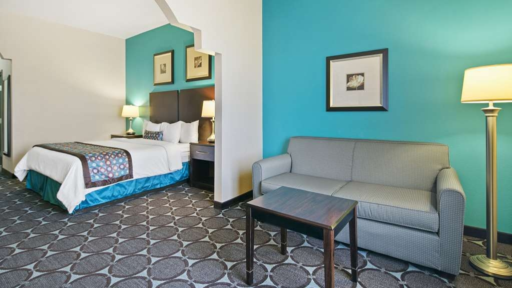 Best Western Sonora Inn & Suites - King Suite - welcome and relax to our large king suites with two televisions.