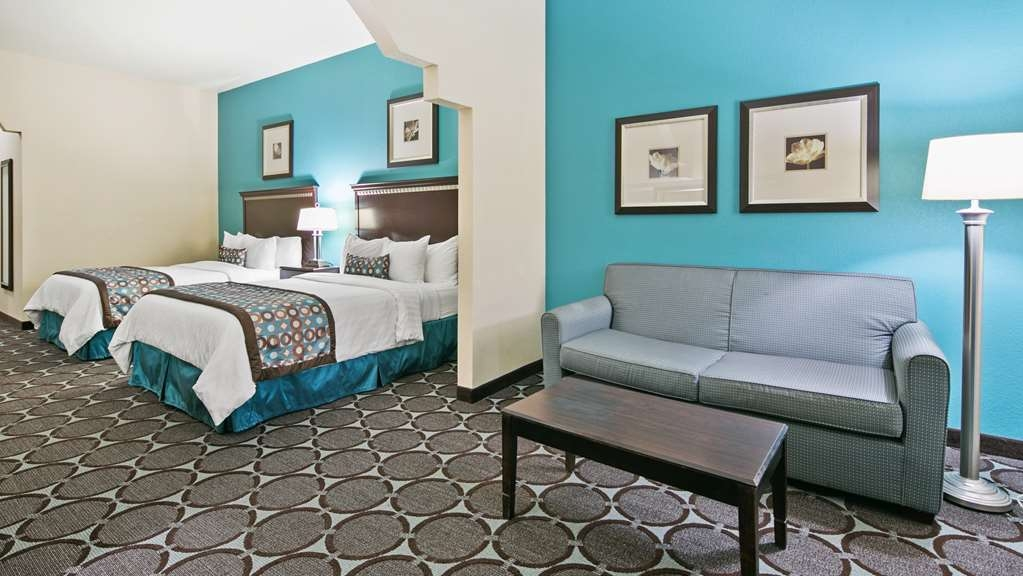 Best Western Sonora Inn & Suites - Two Queen Bed Suite Guest Room with a sofa to sit and work or sit and relax