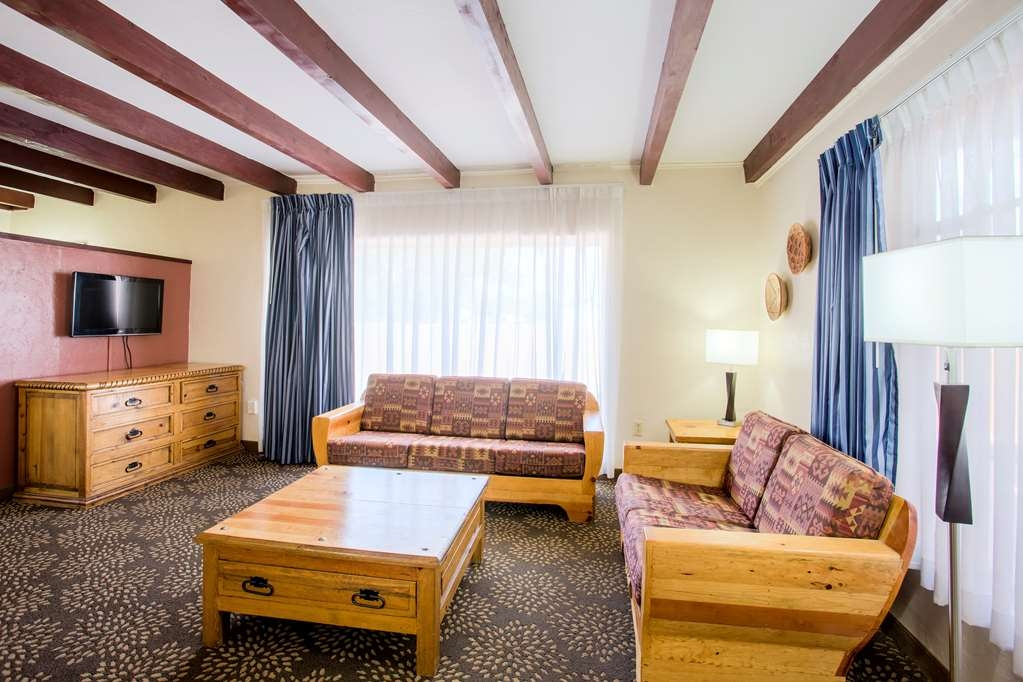 Best Western Mission Inn - Our King Suite offers ample space to relax after a long day of traveling.
