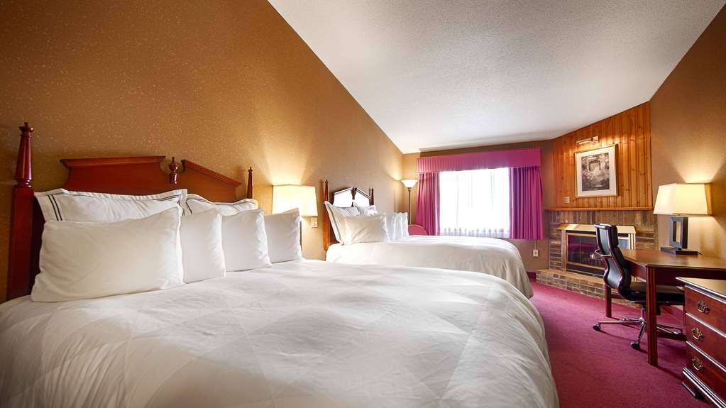Best Western University Inn - Traveling with a family? Our two queen guest room with a fireplace is the perfect size.