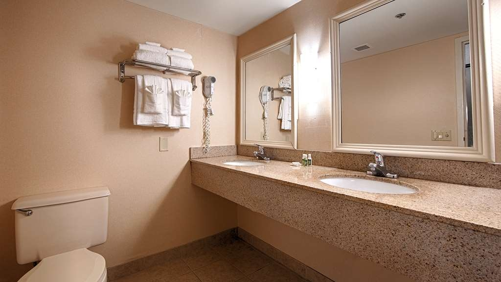 Best Western University Inn - All guest bathrooms have a large vanity with plenty of room to unpack the necessities.