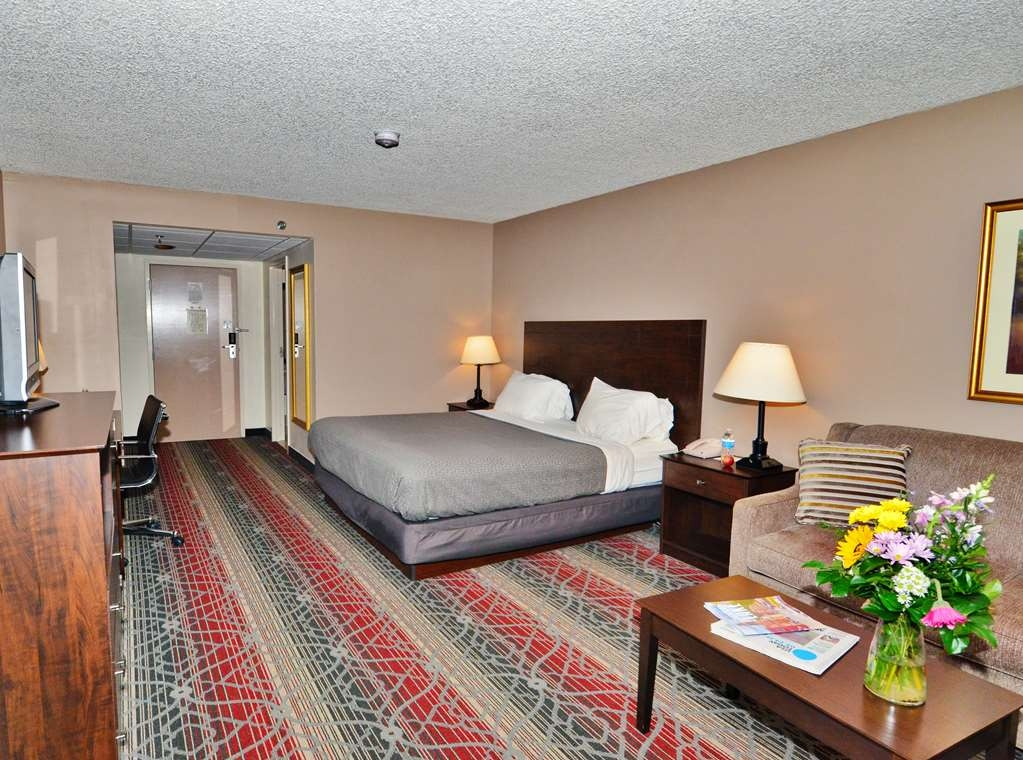 Best Western Saranac Lake - Relax in our spacious King Bedroom with ample living space and modern decor.