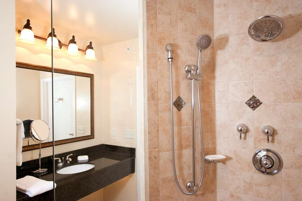 Best Western Plus Vineyard Inn & Suites - Our Deluxe King Suite comes with a tiled walk in shower and double vanity.