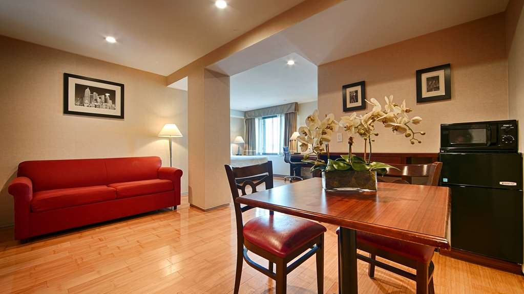 Best Western Bowery Hanbee Hotel - This king suite features a sofabed microwave fridge flat screen TV and free high-speed wireless Internet!