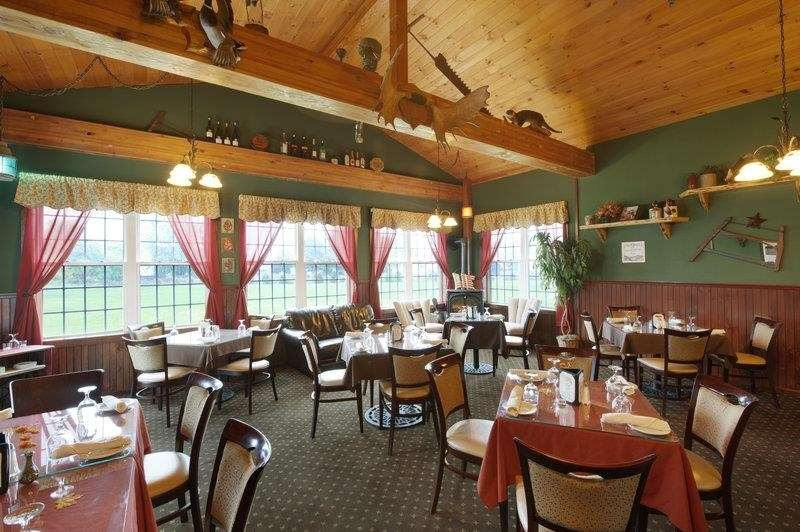 Best Western Plus Ticonderoga Inn & Suites - The Burgoyne Grill an Adirondack style pub and restaurant offers an eclectic array of foods.