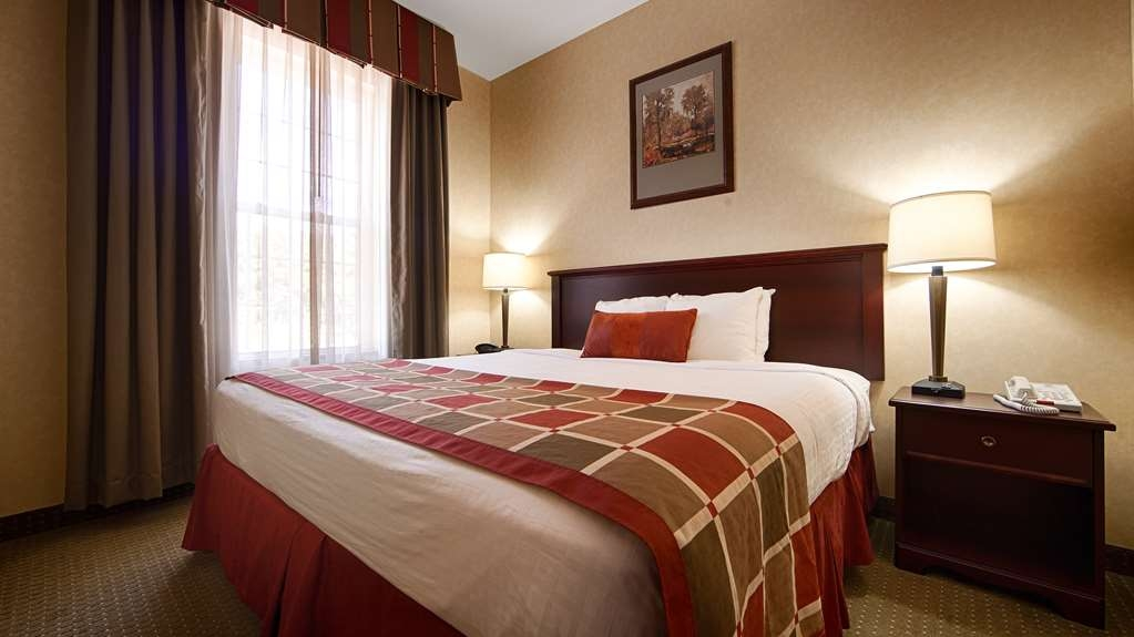 Best Western Plus Ticonderoga Inn & Suites - Our king suite is very spacious and offers you a comfortable place to unwind.