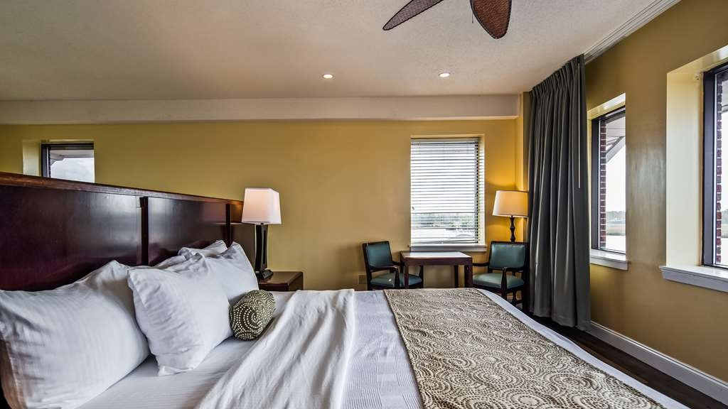 Best Western Plus Coastline Inn - The bedroom for the Tower Suite is located in the Loft of the suite and overlooks the Cape Fear River