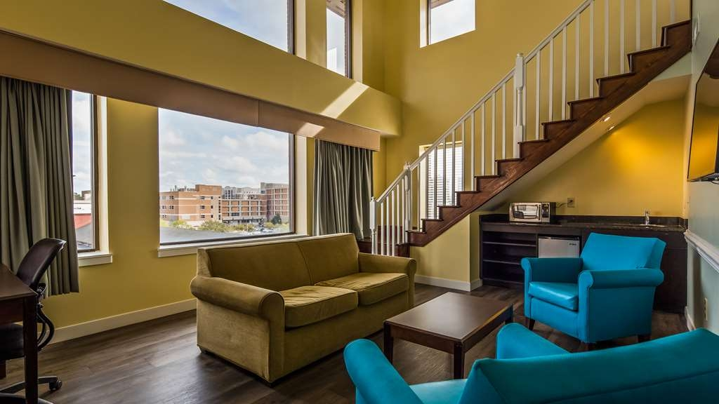Best Western Plus Coastline Inn - The living room of the Tower Suite is overlooking the City. Room has a microwave, fridge and 43 inch color TV. Also in the living room is a full size sleeper sofa.