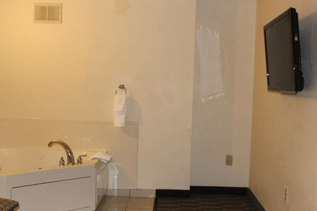 "Best Western Plus Yadkin Valley Inn & Suites - Jacuzzi Suite with King Bed & Upholstered Comfort Chair. Jacuzzi and additional 42"" TV in separate area of the Room. Coffee Maker, Refrigerator, Microwave, Iron - Ironing Board, and Hair Dryer."
