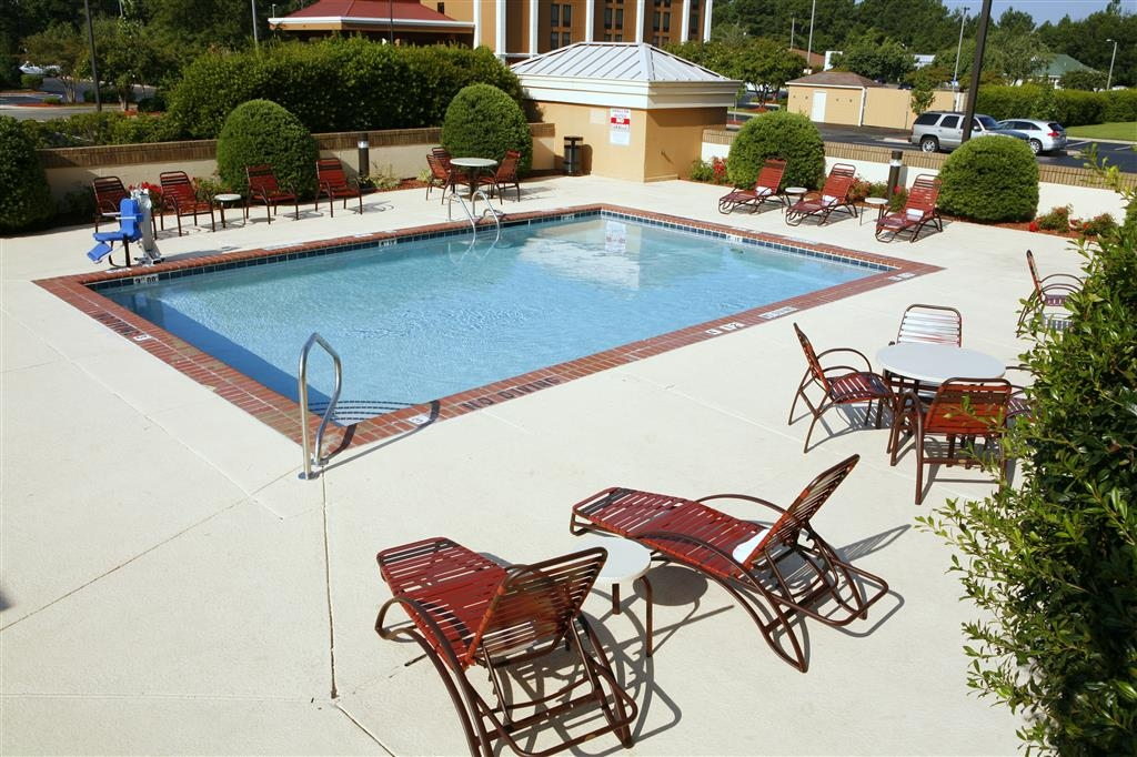 Best Western Plus Goldsboro - Soak up the sun in one of our comfortable lounge chairs by our outdoor swimming pool.