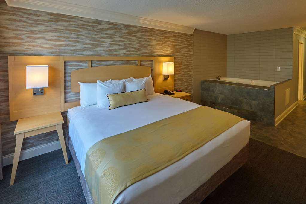 Best Western Plus University Inn - King Jacuzzi Guestroom Non-Smoking, Refrigerator, Pillow Top Mattress, Full Breakfast, High Speed Internet Access Can be attached to Living Room and/or Standard Queen Queen Room