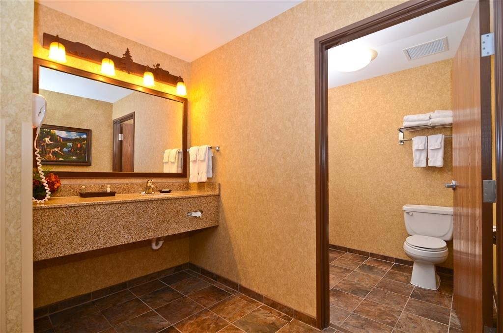 Best Western Plus Kelly Inn & Suites - Our Pine Creek guest room also features a vanity for you and visiting guests!