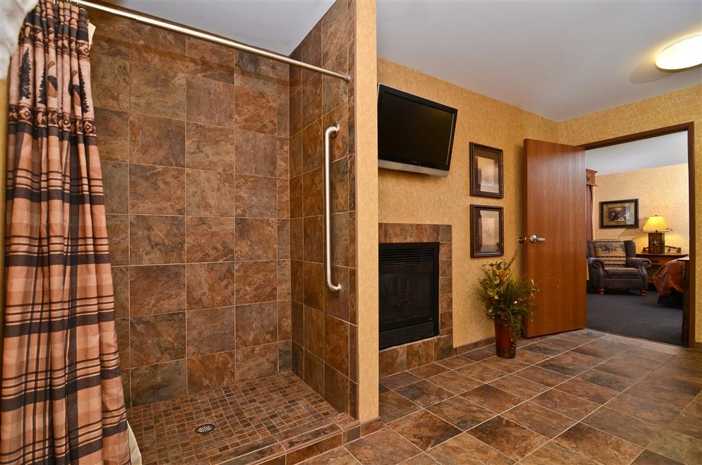 Best Western Plus Kelly Inn & Suites - Come and enjoy our spacious shower and double sided fireplace in our Alamo Suite!