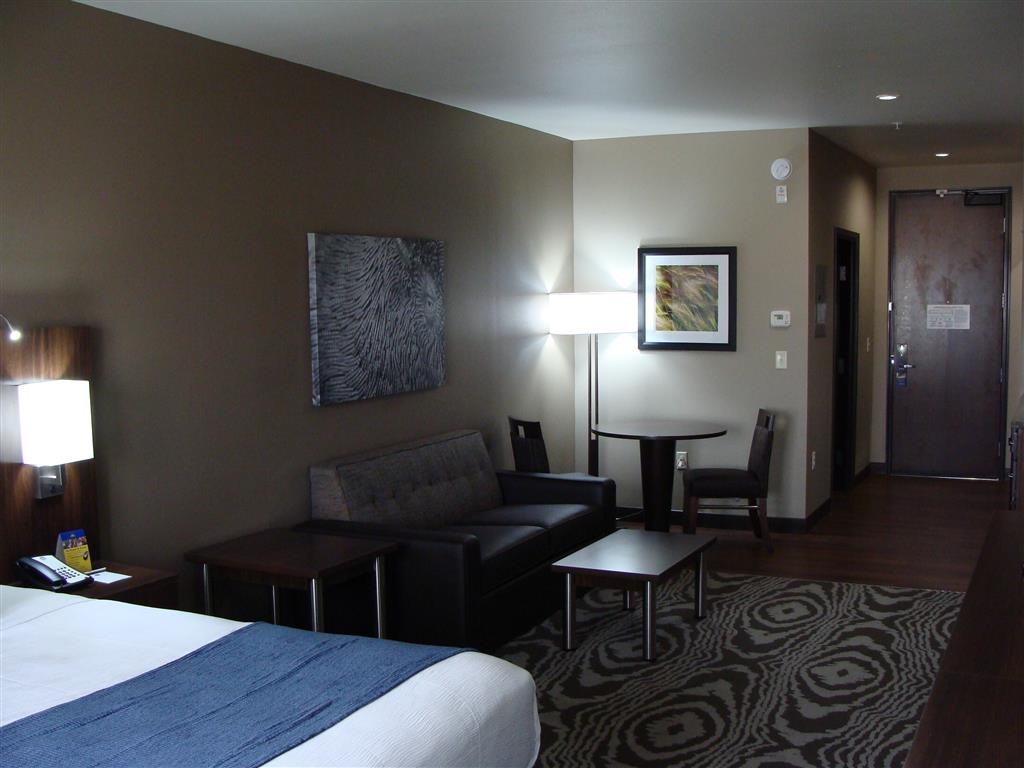 Best Western Plus Williston Hotel & Suites - Relax after a long day of travel in our suite bedroom.