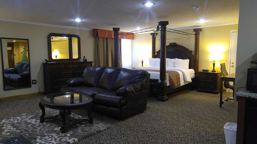 Best Western Wooster Hotel - Our Honeymoon Suite features a pull-out couch with a full-sized mattress and expansive living space.