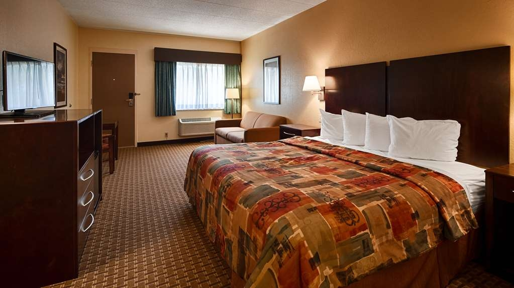 Best Western Port Clinton - King bedroom includes microwave, refrigerator, coffee maker, and free high-speed Internet.