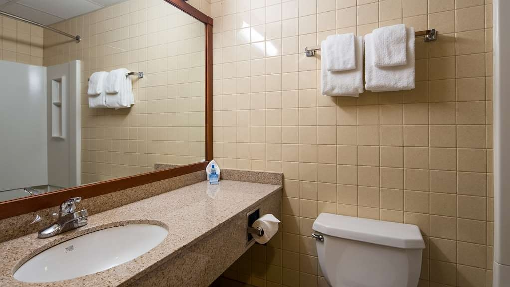 Best Western Port Clinton - All guest bathrooms have a large granite vanity with plenty of room to unpack the necessities.