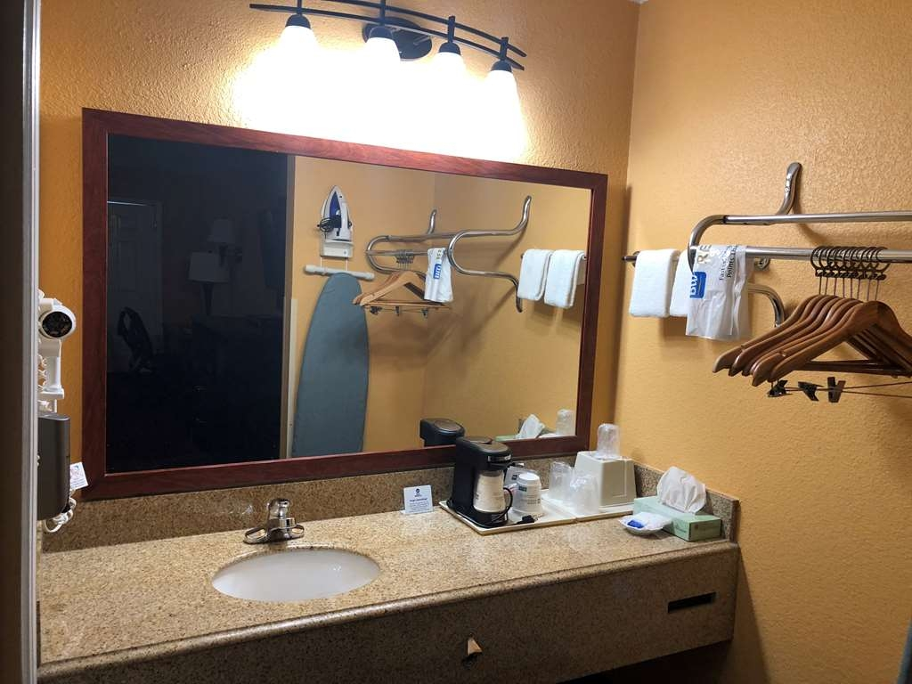 Best Western Executive Inn - All guest bathrooms have a large vanity with plenty of room to unpack the necessities.