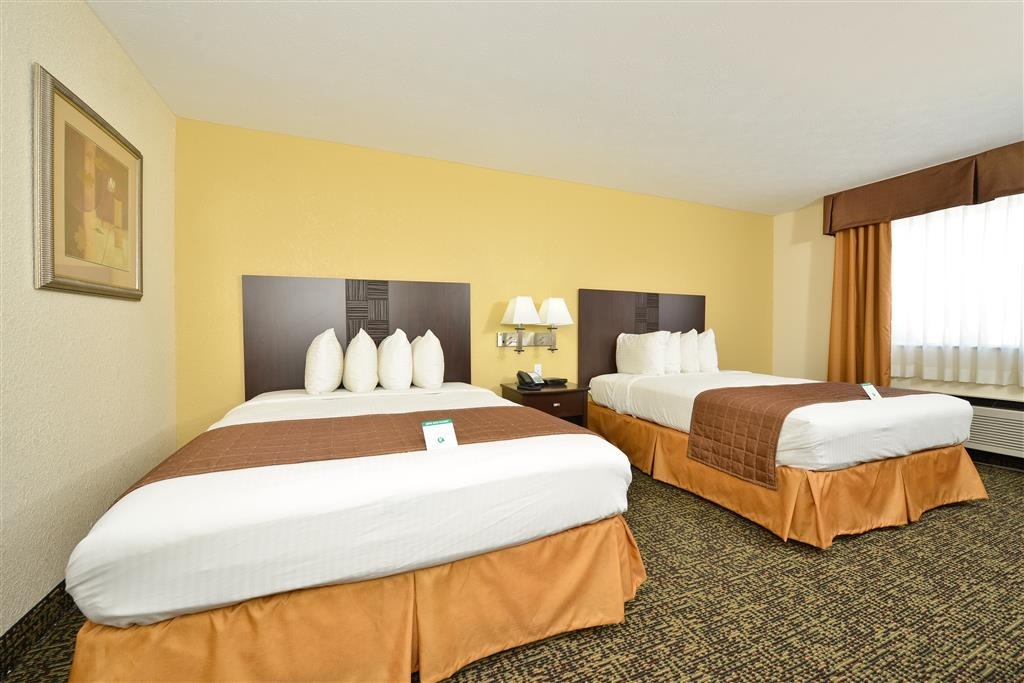Best Western Inn - Relax after a long day of travel in our comfy two queen guest room.