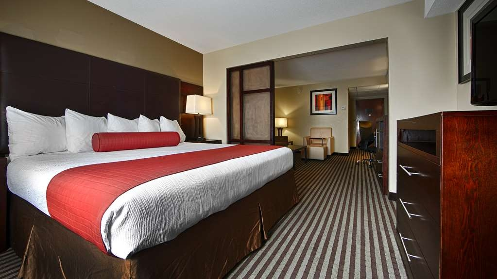 Best Western Plus West Akron Inn & Suites - Our junior suite with a sofa bed/seating area is divided by a partial wall.