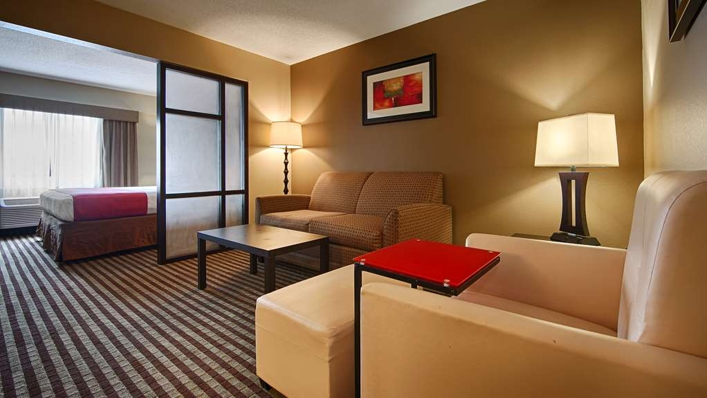 Best Western Plus West Akron Inn & Suites - The junior suite is separated by a partial wall splitting your one room into two spaces.