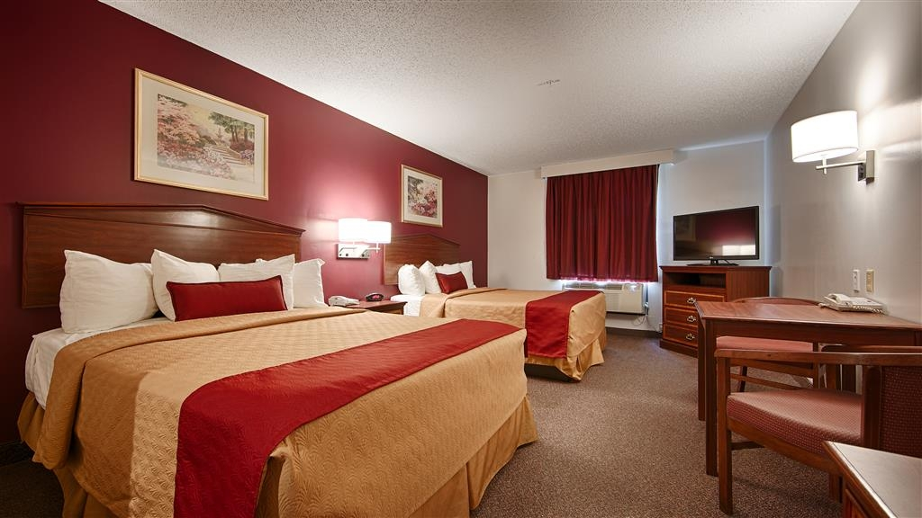 Best Western Okmulgee - Relax after a long day of travel in our two queen bed guest room with a microwave and refrigerator.