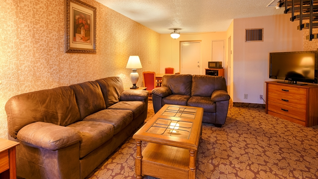 Best Western Airport - Located downstairs our king suite living room has a couch, love seat and television.