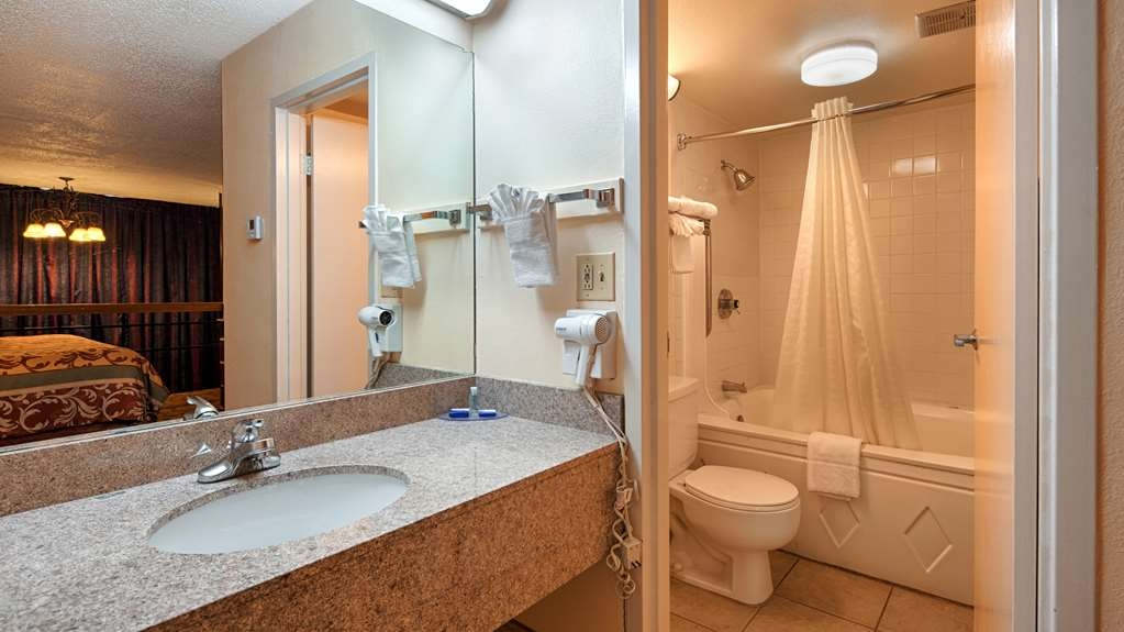 Best Western Airport - The second story of our loft-style king suite features a king Euro top bed and a full bathroom with a two-person whirlpool tub.