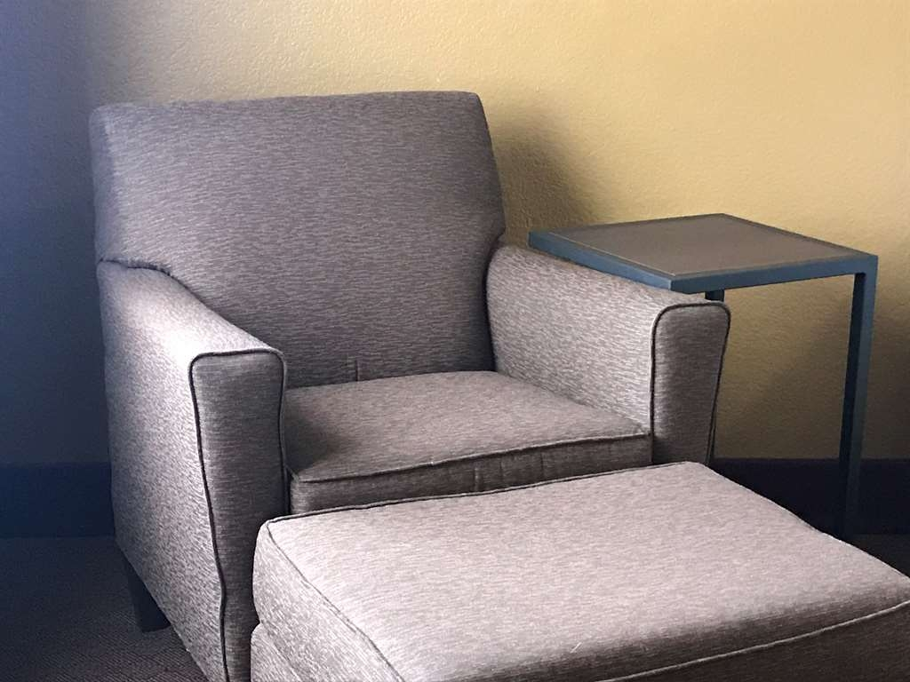 Best Western Plus Yukon - Nestle into this chair and ottoman.