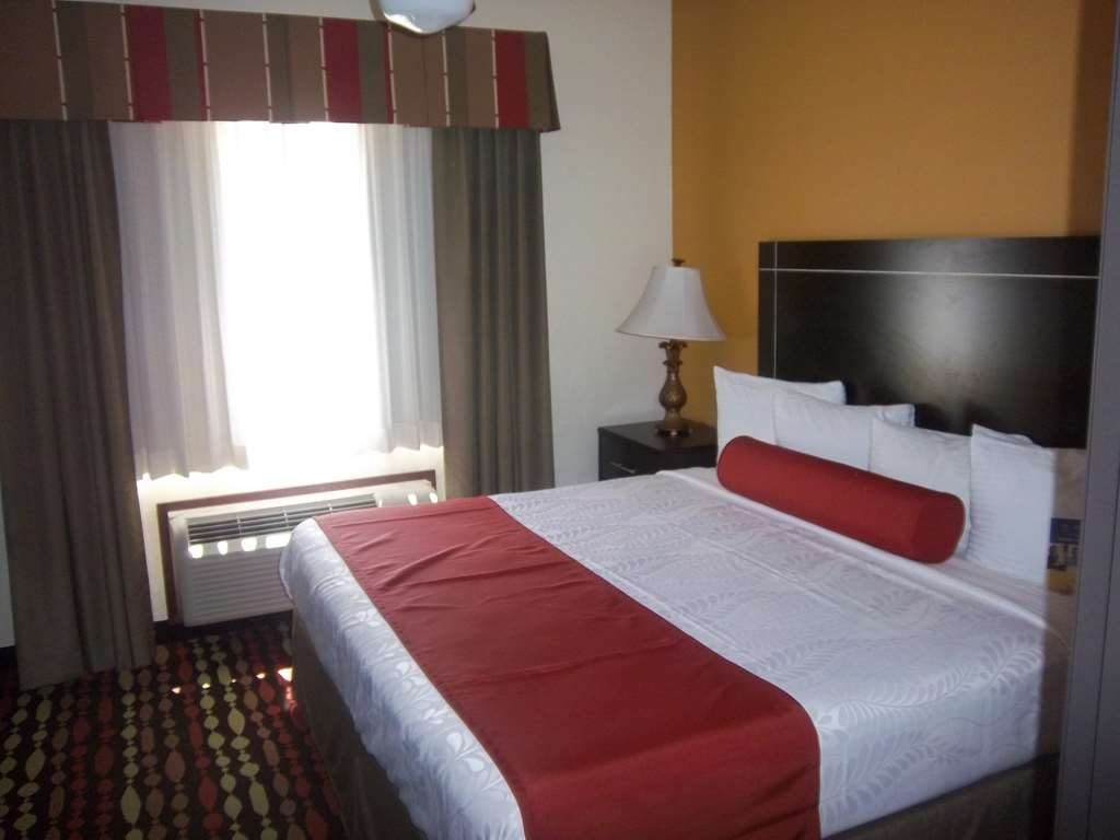 Best Western Greentree Inn & Suites - Get a restful night of sleep in our king guest room that has a separate living area.