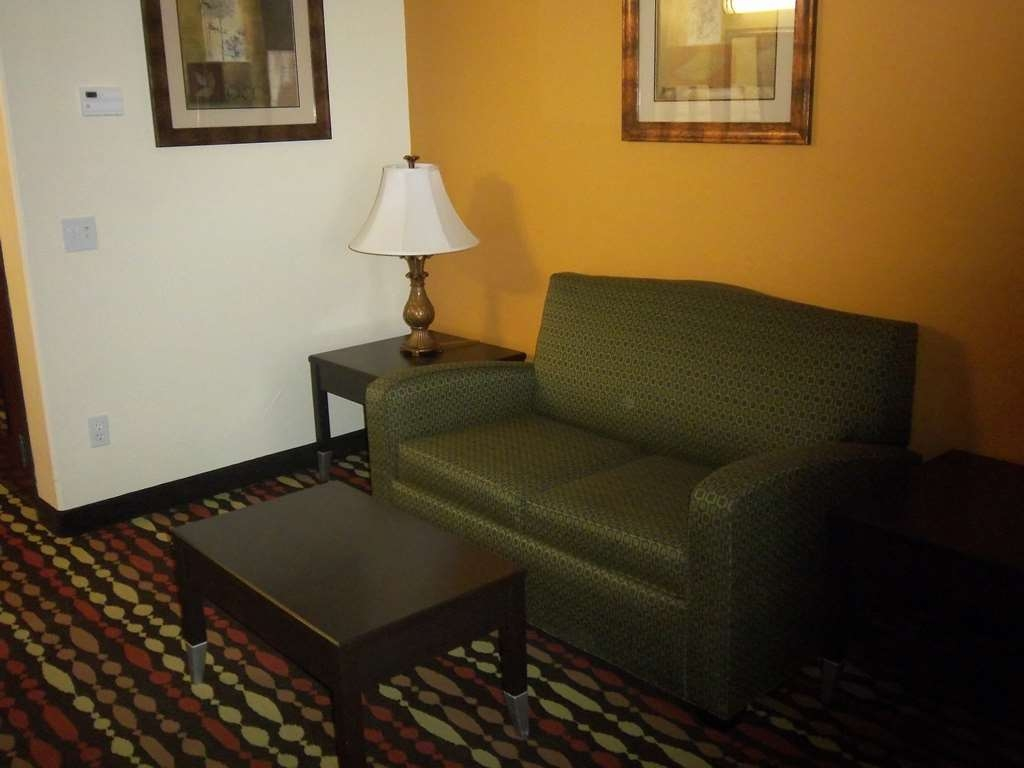 Best Western Greentree Inn & Suites - The separate seating area in our guest rooms allow you to meet up with friends or family in your room!