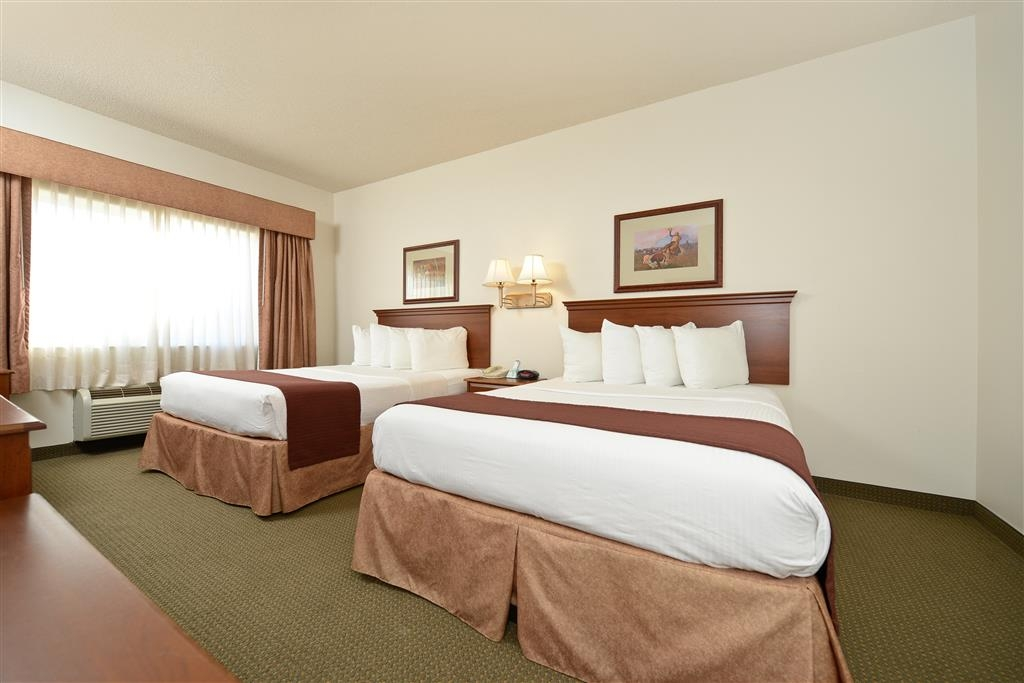 Best Western Blackwell Inn - Stay connected in our 2 queen bed guest room that offers wired and wireless high-speed Internet access.