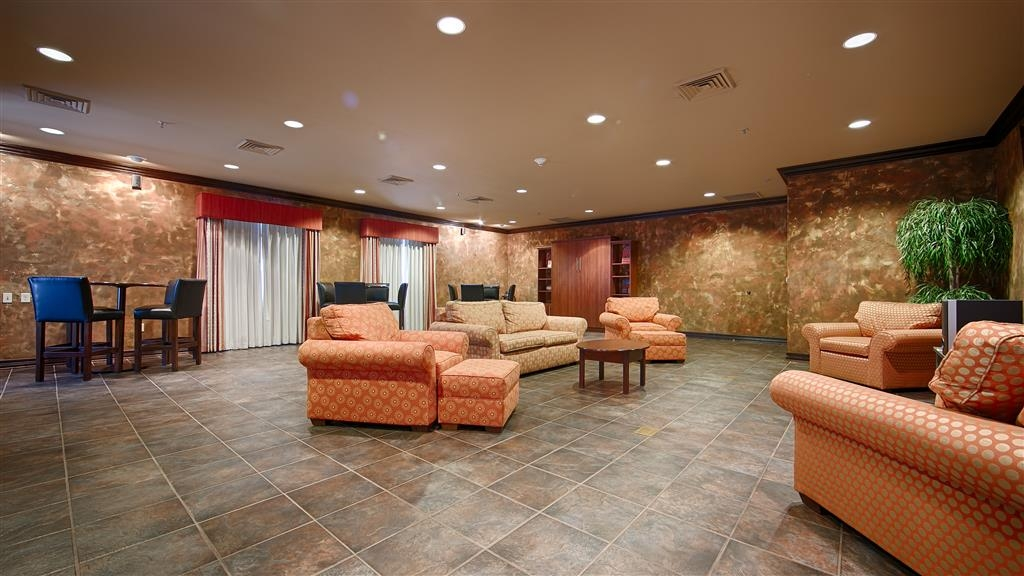 Best Western Plus Cimarron Hotel & Suites - The Cowboy Suite can accommodate up to 40 people and includes a private bathroom, bistro tables, and a view of Boone Pickens Stadium.